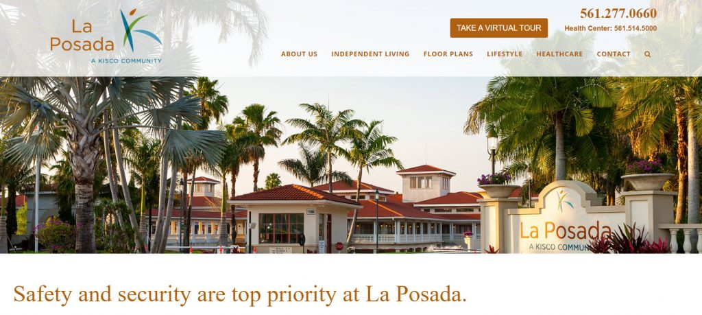 Banner image on La Posada senior living website that shows guard gate at the community surrounded by palm trees.
